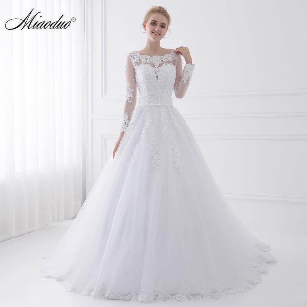 Long sleeve sheer tulle back princess wedding dress for Long sleeve sheer wedding dresses