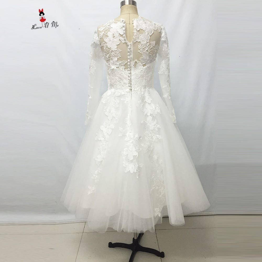 Elegant ivory lace long sleeves tea length wedding dress for Elegant long sleeve wedding dresses