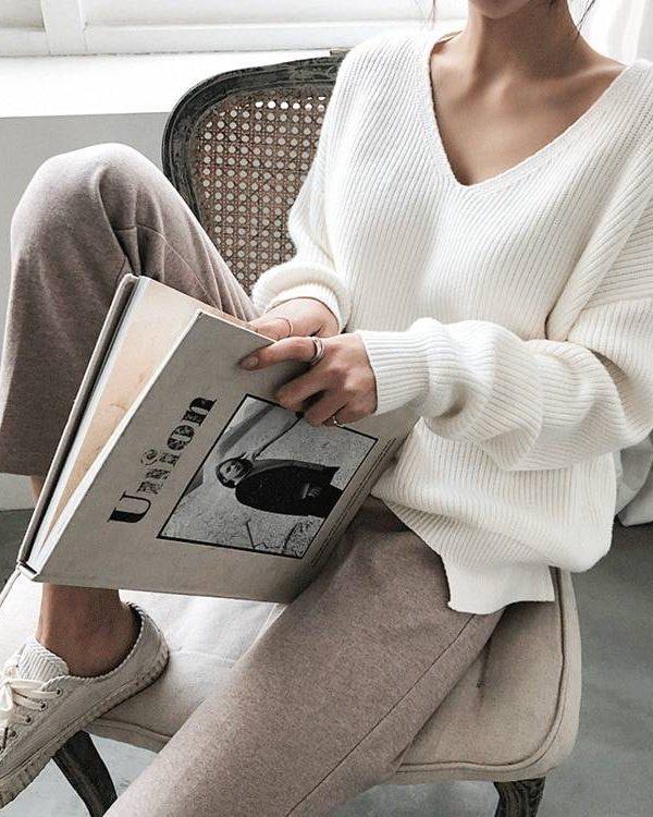 V-neck minimalist irregular hem knitted casual sweater