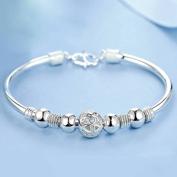 Silver lucky charm cuff bracelet